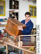 Купить «Restorer of furniture in workroom», фото № 30447396, снято 8 апреля 2017 г. (c) Яков Филимонов / Фотобанк Лори