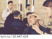Woman barber shaving client with straight razor. Стоковое фото, фотограф Яков Филимонов / Фотобанк Лори