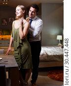 Купить «Loving couple in apartment», фото № 30447448, снято 24 сентября 2018 г. (c) Яков Филимонов / Фотобанк Лори