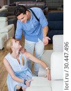 Купить «Happy couple are choosing new sofa-transformer», фото № 30447496, снято 19 июня 2017 г. (c) Яков Филимонов / Фотобанк Лори