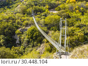 Suspension bridge through the Abandoned cave city of Khndzoresk in Armenia (2018 год). Стоковое фото, фотограф Наталья Волкова / Фотобанк Лори