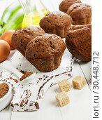Купить «Chocolate muffins with zucchini», фото № 30448712, снято 23 октября 2018 г. (c) Надежда Мишкова / Фотобанк Лори