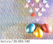 Купить «Easter background. Colored pearl eggs of gold, pink, coral, blue and turquoise on a halo background with a copy space», фото № 30450140, снято 31 марта 2019 г. (c) Светлана Евграфова / Фотобанк Лори