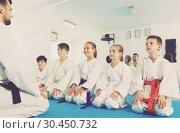 Купить «Young children in karate class», фото № 30450732, снято 25 марта 2017 г. (c) Яков Филимонов / Фотобанк Лори