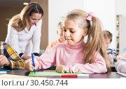 Купить «Children of elementary age having class of art», фото № 30450744, снято 5 ноября 2016 г. (c) Яков Филимонов / Фотобанк Лори