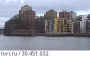 Купить «Сумрачный мартовский день в современном Стокгольме. Швеция», видеоролик № 30451032, снято 9 марта 2019 г. (c) Виктор Карасев / Фотобанк Лори