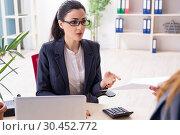 Купить «Young female employee being fired from her work», фото № 30452772, снято 15 января 2019 г. (c) Elnur / Фотобанк Лори