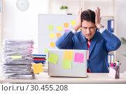 Купить «Young male handsome employee in conflicting priorities concept», фото № 30455208, снято 7 января 2019 г. (c) Elnur / Фотобанк Лори