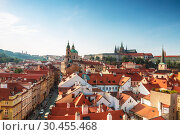 Купить «View of Prague rooftops, St. Vitus Cathedral and St. Nicholas Cathedral. Czech republic», фото № 30455468, снято 5 сентября 2014 г. (c) Наталья Волкова / Фотобанк Лори