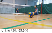 Купить «RUSSIA, KAZAN. 09-02-2019: Sports for disabled people. Rolling the ball to a young women sitting on the floor», видеоролик № 30465540, снято 26 апреля 2019 г. (c) Константин Шишкин / Фотобанк Лори
