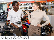 Купить «Young couple looking for new motorcycle in salon, dissatisfied woman expressing displeasure», фото № 30474208, снято 16 января 2019 г. (c) Яков Филимонов / Фотобанк Лори