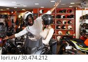 Купить «Cheery young couple laughing sitting on bike», фото № 30474212, снято 16 января 2019 г. (c) Яков Филимонов / Фотобанк Лори