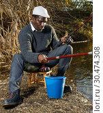 Fisherman sitting on wooden stool. Стоковое фото, фотограф Яков Филимонов / Фотобанк Лори