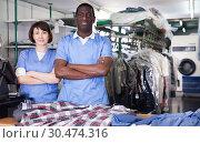 Купить «Two confident workers of dry cleaner», фото № 30474316, снято 15 января 2019 г. (c) Яков Филимонов / Фотобанк Лори