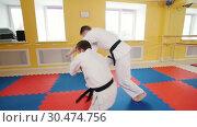 Athletic men training their aikido skills. Protection technique using the weight of the opponent. Стоковое видео, видеограф Константин Шишкин / Фотобанк Лори