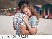 Купить «Happy couple relaxing at beach on a sunny day», фото № 30475296, снято 14 ноября 2018 г. (c) Wavebreak Media / Фотобанк Лори