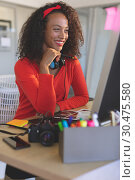 Купить «Female graphic designer working on desktop pc at desk in a modern office», фото № 30475580, снято 18 ноября 2018 г. (c) Wavebreak Media / Фотобанк Лори