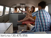Купить «Group of friends giving high five in camper van at beach», фото № 30475956, снято 9 января 2019 г. (c) Wavebreak Media / Фотобанк Лори