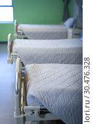 Купить «Row of empty hospital beds », фото № 30476328, снято 26 января 2019 г. (c) Wavebreak Media / Фотобанк Лори