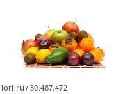 Купить «Fresh juicy fruits on a white background», фото № 30487472, снято 17 декабря 2011 г. (c) Ласточкин Евгений / Фотобанк Лори