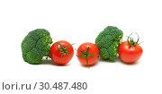 Купить «Tomatoes and broccoli isolated on white background», фото № 30487480, снято 19 мая 2014 г. (c) Ласточкин Евгений / Фотобанк Лори