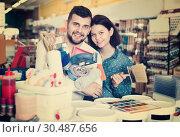 Купить «Couple purchasing tools for house improvements in paint supplies store», фото № 30487656, снято 9 марта 2017 г. (c) Яков Филимонов / Фотобанк Лори