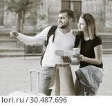 Купить «Young tourists with map and baggage hugging», фото № 30487696, снято 25 мая 2017 г. (c) Яков Филимонов / Фотобанк Лори