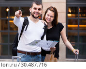 Купить «Happy man and woman traveling with map and baggage», фото № 30487716, снято 25 мая 2017 г. (c) Яков Филимонов / Фотобанк Лори