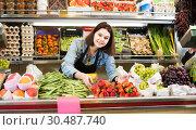 Купить «Female shopping assistant demonstrating assortment of grocery shop», фото № 30487740, снято 18 марта 2017 г. (c) Яков Филимонов / Фотобанк Лори