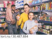 Купить «Happy family with two little girls buying food products in super», фото № 30487884, снято 20 января 2018 г. (c) Яков Филимонов / Фотобанк Лори