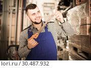 Купить «Worker man showing various tools at workplace», фото № 30487932, снято 15 марта 2017 г. (c) Яков Филимонов / Фотобанк Лори