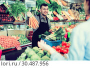 Купить «Male seller assisting in buying», фото № 30487956, снято 18 марта 2017 г. (c) Яков Филимонов / Фотобанк Лори