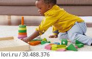 Купить «african american baby boy playing with toy blocks», видеоролик № 30488376, снято 24 марта 2019 г. (c) Syda Productions / Фотобанк Лори