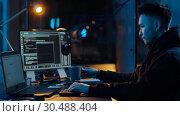 Купить «hacker using computer for cyber attack at night», видеоролик № 30488404, снято 30 марта 2019 г. (c) Syda Productions / Фотобанк Лори
