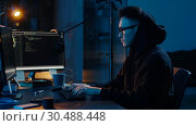 Купить «hacker in hoodie using computers for cyber attack», видеоролик № 30488448, снято 30 марта 2019 г. (c) Syda Productions / Фотобанк Лори