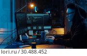 Купить «hacker using computer for cyber attack at night», видеоролик № 30488452, снято 30 марта 2019 г. (c) Syda Productions / Фотобанк Лори
