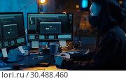 Купить «hacker using computer for cyber attack at night», видеоролик № 30488460, снято 30 марта 2019 г. (c) Syda Productions / Фотобанк Лори