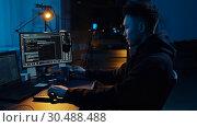 Купить «hacker using computer for cyber attack at night», видеоролик № 30488488, снято 30 марта 2019 г. (c) Syda Productions / Фотобанк Лори