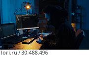 Купить «hacker using computer for cyber attack at night», видеоролик № 30488496, снято 30 марта 2019 г. (c) Syda Productions / Фотобанк Лори