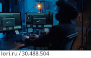 Купить «hacker using computer for cyber attack at night», видеоролик № 30488504, снято 30 марта 2019 г. (c) Syda Productions / Фотобанк Лори
