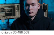 Купить «asian hacker in dark room with computers at night», видеоролик № 30488508, снято 30 марта 2019 г. (c) Syda Productions / Фотобанк Лори