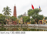 Купить «Tran Quoc Pagoda (Chua Tran Quoc) is the oldest pagoda in Hanoi, originally constructed in the sixth century during the reign of Emperor Ly Nam De. The...», фото № 30488668, снято 4 февраля 2019 г. (c) age Fotostock / Фотобанк Лори