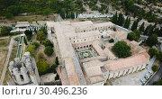 Купить «Aerial view of Romanesque Benedictine Abbey Sainte-Marie d'Orbieu in commune of Lagrasse in southern France», видеоролик № 30496236, снято 26 октября 2018 г. (c) Яков Филимонов / Фотобанк Лори