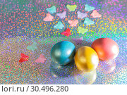 Купить «Easter background. Colored pearl eggs of gold, pink, coral, blue and turquoise on a halo background with a copy space», фото № 30496280, снято 31 марта 2019 г. (c) Светлана Евграфова / Фотобанк Лори