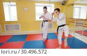 Two men training their aikido skills in the studio. Warming up before training. Стоковое видео, видеограф Константин Шишкин / Фотобанк Лори