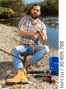 Купить «Lucky fisherman caught a trout fish», фото № 30499788, снято 15 марта 2019 г. (c) Яков Филимонов / Фотобанк Лори