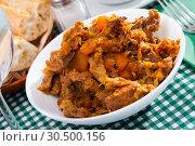 Купить «Braised cabbage with pork», фото № 30500156, снято 17 июля 2019 г. (c) Яков Филимонов / Фотобанк Лори