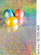 Купить «Easter background. Colored pearl eggs of gold, pink, coral, blue and turquoise on a halo background with a copy space», фото № 30500468, снято 31 марта 2019 г. (c) Светлана Евграфова / Фотобанк Лори