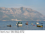 Купить «Boats anchored in the bay of city Budva», фото № 30502072, снято 8 августа 2017 г. (c) Алексей Голованов / Фотобанк Лори