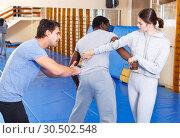 Купить «People fighting with coach at gym», фото № 30502548, снято 31 октября 2018 г. (c) Яков Филимонов / Фотобанк Лори